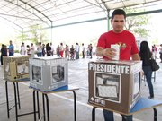 A voter casts his ballot for Mexico's 2012 presidential election in Ciudad Juárez on Sunday.
