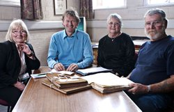 Michael Wood, Pat Grundy and Neil and Jane Beasley researching Neil's ancestor who was deported to Australia in 1798.