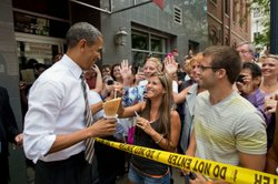 President Barack Obama greets people gathered outside of Deb's Ice Cream & Deli in Cedar Rapids, Iowa, July 10, 2012.