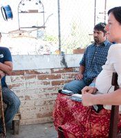 Jesus Castro Romo speaks with legal investigator Marcelo Ruiz and reporter Roxana Popescu at his home in Nogales, Mexico, on Wednesday, June 27, 2012.