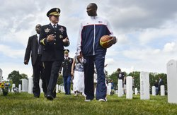 Army Gen. Martin E. Dempsey, chairman of the Joint Chiefs of Staff, walks with professional basketball player Kobe Bryant at Arlington National Cemetery