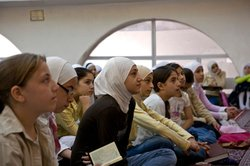 Riham Baalbaki, center, listens to a lecture at Al Zahra Mosque.