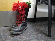 These are boots that Detective Ellen Vest said are evidence their owners were white extremists. The red laces mean the owner had spilled blood for their cause.