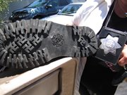 These are boots that Detective Ellen Vest said are evidence their owners were white extremists. They have swastikas on the soles.