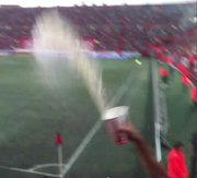 A blurry screen grab of a Xolos beer shower celebration during the season opener July 20, 2012.