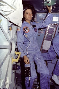 Floating on the Middeck, Sally Ride floats alongside Challenger's middeck airlock hatch.