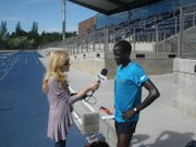 Guor Marial speaks with KNAU&#39;S Janice Baker at the Northern Arizona University track in Flagstaff, Ariz.