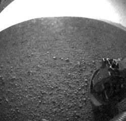 In this handout image provided by NASA/JPL-Caltech, one of the first images taken by NASA's Curiosity rover, which landed on Mars on the evening of August 5, 2012 PDT and transmitted to Spaceflight Operations Facility for NASA's Mars Science Laboratory Curiosity rover at Jet Propulsion Laboratory (JPL) in Pasadena, California.