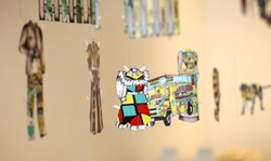 "A paper doll from ""44th and Landis"" with a rubik's cube print."