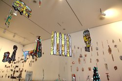 """44th and Landis"" features 400 paper dolls suspended from the ceiling and a 14-channel sonic landscape."