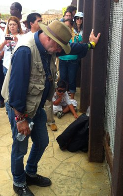 Poet/activist Javier Sicilia listens to people in Tijuana talk about loved ones lost to Mexico&#39;s ongoing war against drug cartels.