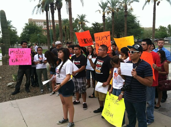 "Deborah Robles, a ""documented DREAMer"" and organizer with the Arizona DREAM Act Coalition, addresses the crowd before they head into the governor's office."
