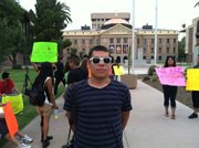 Francisco Luna spent a sleepless night on the lawn outside Arizona's Capitol.