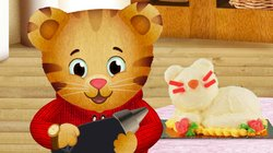 "DANIEL TIGER'S NEIGHBORHOOD stars 4-year-old Daniel Tiger (pictured here, in a story from the pilot episode ""Daniel's Birthday""), son of the original program's Daniel Striped Tiger, who invites young viewers into his world, giving them a kid's eye view of his life."