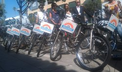 The San Diego County Bicycle Coalition shows off bikes advertising San Diego Bike Friendly Districts at an event on Thursday, Sept. 6. 2012.