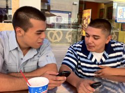 Sam Verdin, left, and Jesus Najera talk about their high school troublemaking and the mentoring that turned them around at San Diego's Mission Valley Mall, Aug. 28, 2012.