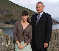 Caroline Catz as Louisa Glasson, and Martin Clunes as the brash doctor Martin Ellingham in the fourth season of DOC MARTIN.