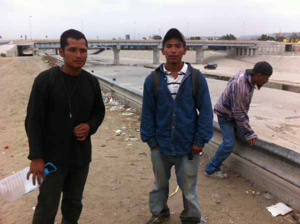Since they were deported, 21-year-old Jose Contreras, right, and a 24-year-old man named Alejandro, spend much of their time on the on the banks of the Tijuana trying to figure out how to get back into the U.S.