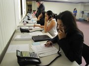 Volunteers answer calls at the Respect-Respeto phone bank in Phoenix for questions regarding Arizona's immigration law.