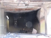 This burnt out garage is believed to have been the target of organized crime. A family died in the fire.