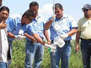 Water treatment plant employees test a raw water sample as part of a two-day training workshop funded by NADBANK.