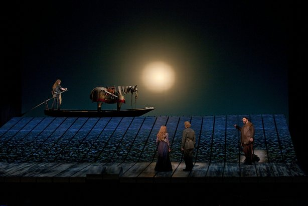 A scene from Wagner&#39;s Gtterdmmerung with Jay Hunter Morris (on boat) as Siegfried, Wendy Bryn Harmer as Gutrune, Iain Paterson as Gunther, and Hans-Peter Knig as Hagen.