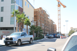 One new apartment building, and one under construction on Lindo Paseo, are an example of the increase in rental housing, aimed at San Diego State students.