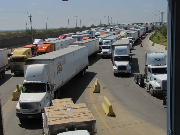 Trucks line up for for inspection at the World Trade Bridge in Laredo, Texas. About 5,000 trucks per day travel through this commercial crossing. 