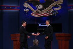 Democratic presidential candidate, U.S. President Barack Obama (R) shakes hands with Republican presidential candidate, former Massachusetts Gov. Mitt Romney (L) during the Presidential Debate at the University of Denver on October 3, 2012 in Denver, Colorado.