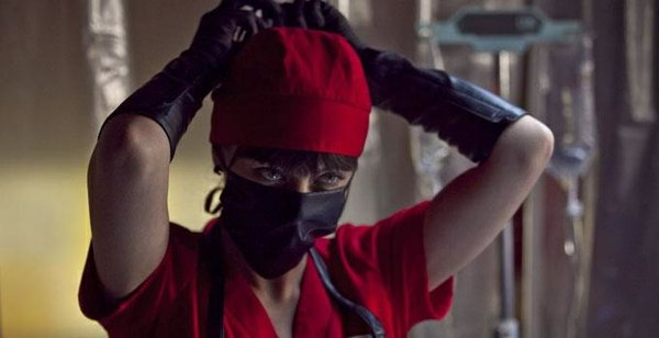 "Katharine Isabelle as Mary doing what she does best in ""American Mary."""