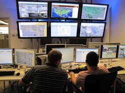 Inside the control room at Secure Origins, engineering students monitor commercial trucks on their journey from warehouse to the international port of entry.