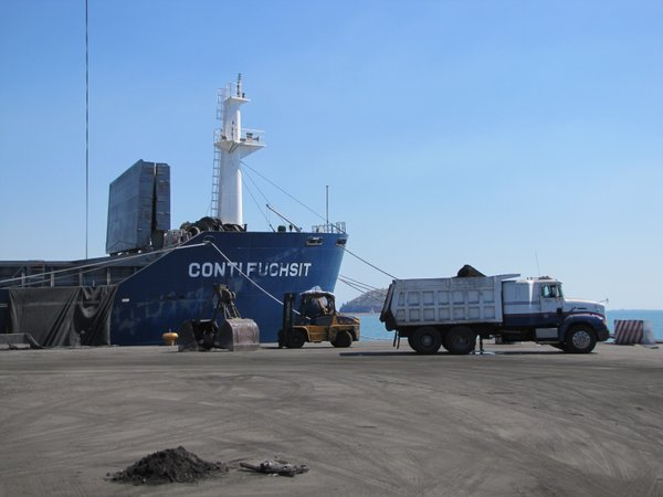 Copper concentrate from Arizona is loaded on a ship bound for China at the port in Guaymas, Mexico.