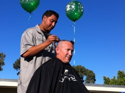 Principal Armando Farias has his head shaved at Baker Elementary, Oct. 26, 2012. Farias promised students if they raised the school's academic performance score, he would shave his head or dye his har. The students chose head shaving.