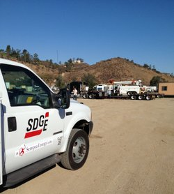 The SDG&amp;E crew&#39;s equipment is loaded onto flatbed trucks to be shipped to the East Coast. There, they will work on restoring power after Hurricane Sandy.