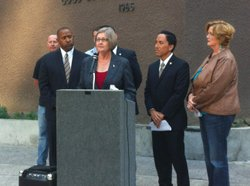 Councilwoman Sherri Lightner responds to Ray Ellis' campaign attacks at a press conference surrounded by her Democratic council colleagues.