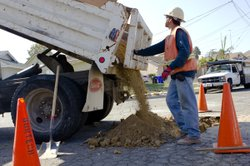 A Burtech Pipeline worker works on one of the streamlined Capital Improvement Program projects in North Clairemont on Nov. 2, 2012.  The project, valued at $4.3 million, is one of 10 that were fast-tracked under the new authority of the mayor's office since July 1.