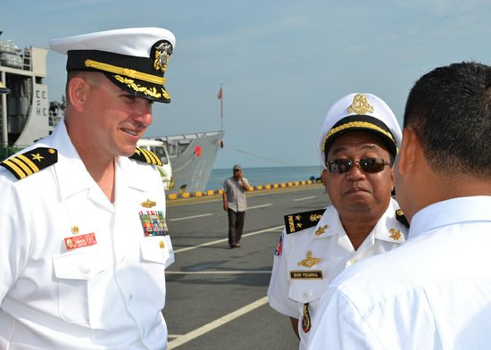 Cmdr. Joseph R. Darlak, commanding officer, USS Vandegrift (FFG 48), communicates with Royal Cambodian Navy Rear Adm. Ros Veasna, deputy commander of Maritime Base via translator about Cooperation Afloat Readiness and Training (CARAT) Cambodia phase 2012.