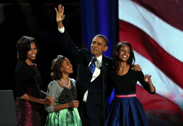 U.S. President Barack Obama walks on stage with first lady Michelle Obama and daughters Sasha and Malia to deliver his victory speech on election night at McCormick Place November 6, 2012 in Chicago, Illinois.