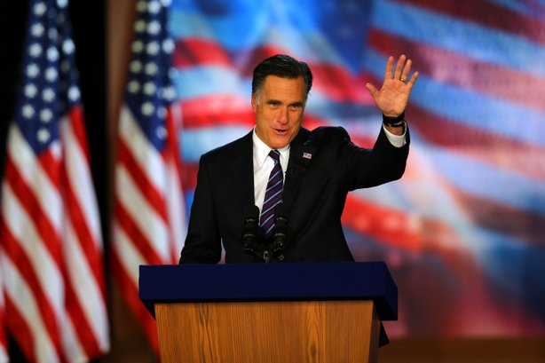 Republican presidential candidate, Mitt Romney, waves to the crowd while speaking at the podium as he concedes the presidency during Mitt Romney's campaign election night event at the Boston Convention & Exhibition Center on November 7, 2012 in Boston, Massachusetts.