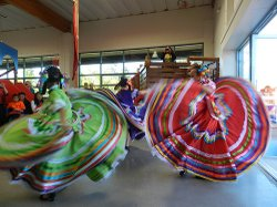 "Las Flores of Academy of World Dance 'n' Arts dancers perform a traditional Mexican dance called ""Jalisco."" In the photo: Tiffany, 8, Cynthia, 9, and Eustazia, 8."