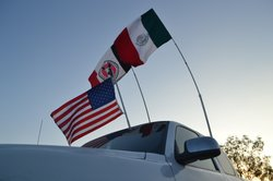 This truck belongs to fan and La Masakr3 photographer Rafael Maya. On game day, it sports these three flags: A Mexican flag, an American flag, and a Xolos flag.