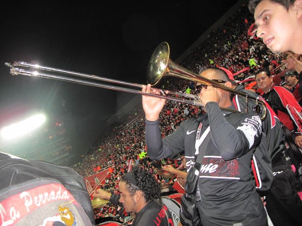 One of the many fans who forms loosely-knit musical groups to play during the game. Other popular instruments are drums, tubas, and the loved and loathed vuvuzelas.