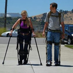 Amanda, a paraplegic who spent 20 years in a wheelchair before this exoskelton allowed her to walk unassisted and David Pogue, wearing a military exoskelton that lets him carry 350 pounds as though it's nothing.