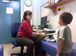 Corinne McCarthy, a San Diego Unified nursing coordinator for schools from Linda Vista to Tierrasanta, prepares to give a Carson Elementary student a hearing screening, Oct. 25, 2012.
