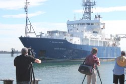 "TV photographers capture the return to San Diego Bay of the research vessel ""Roger Revelle,"" which had been at sea for six years."