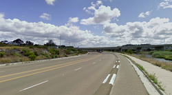 One of the few cycle tracks in San Diego is found on this stretch of Friar&#39;s Road, where a short concrete barrier separates car and bike traffic.  
