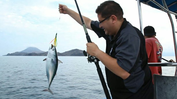 CROSSING SOUTH host Jorge Meraz catches a skipjack tuna while staying in Bahia de Los Angeles. Fishing was good, he caught about five fish in 30 minutes.