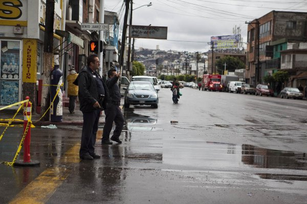 Tijuana police redirect traffic at an intersection due to flooding, December 13, 2012.