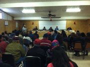 More than a hundred people filled the Dilkon Chapter House on the Navajo Nation to air their grievances about car dealers.