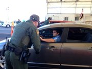 A U.S. Border Patrol agent questions drivers traveling north on Interstate 19 in southern Arizona.